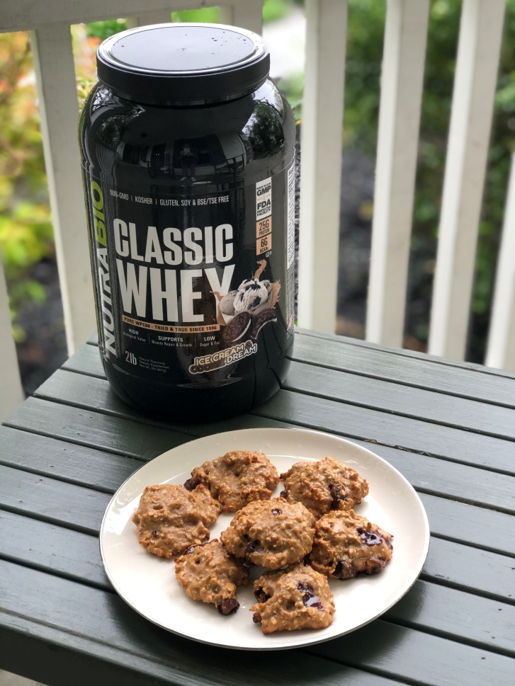 NutraBio Classic Whey bottle next to homemade protein cookies