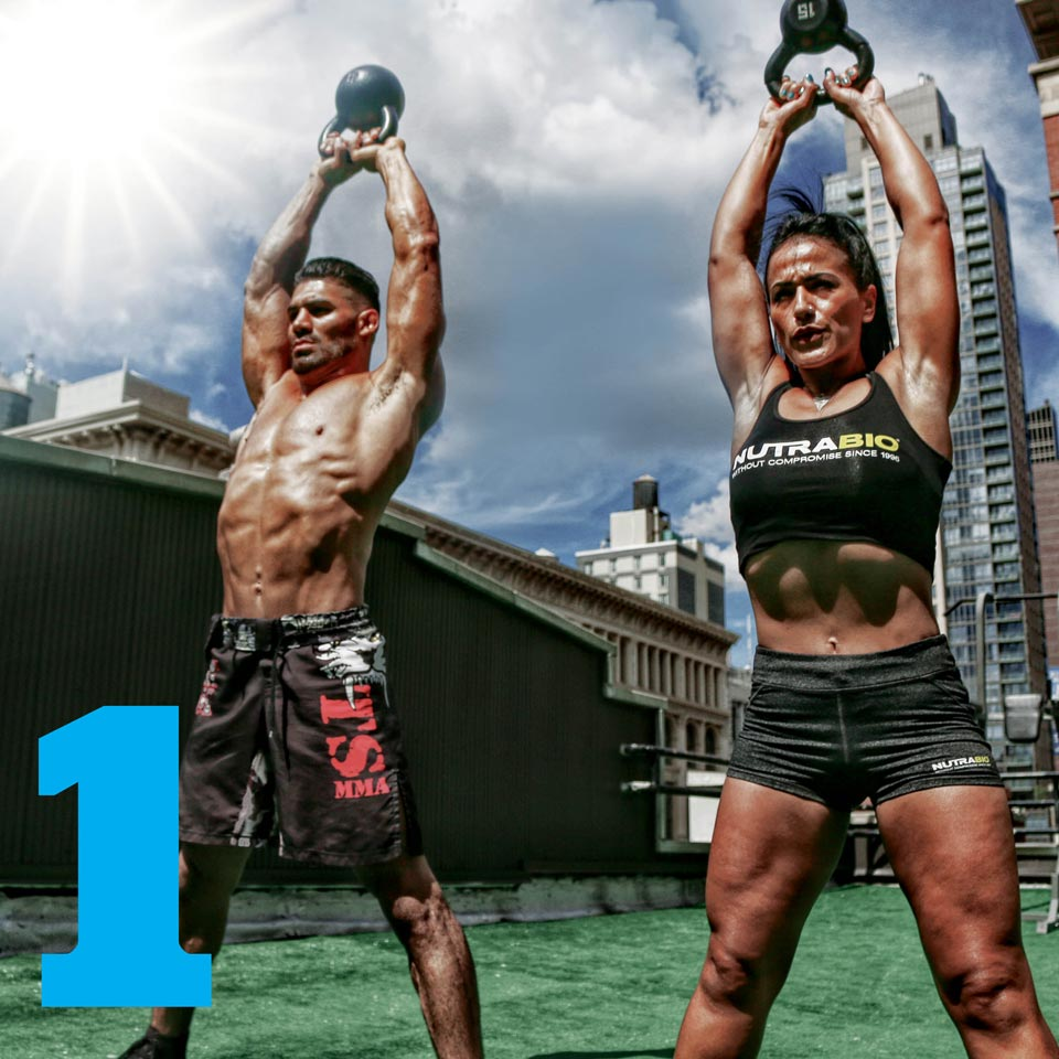 A man and woman doing a kettle bell workout outdoors.