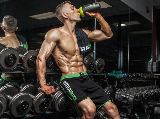 Zane Hadzick, wearing Nutraio apparel and holding a shaker bottle.